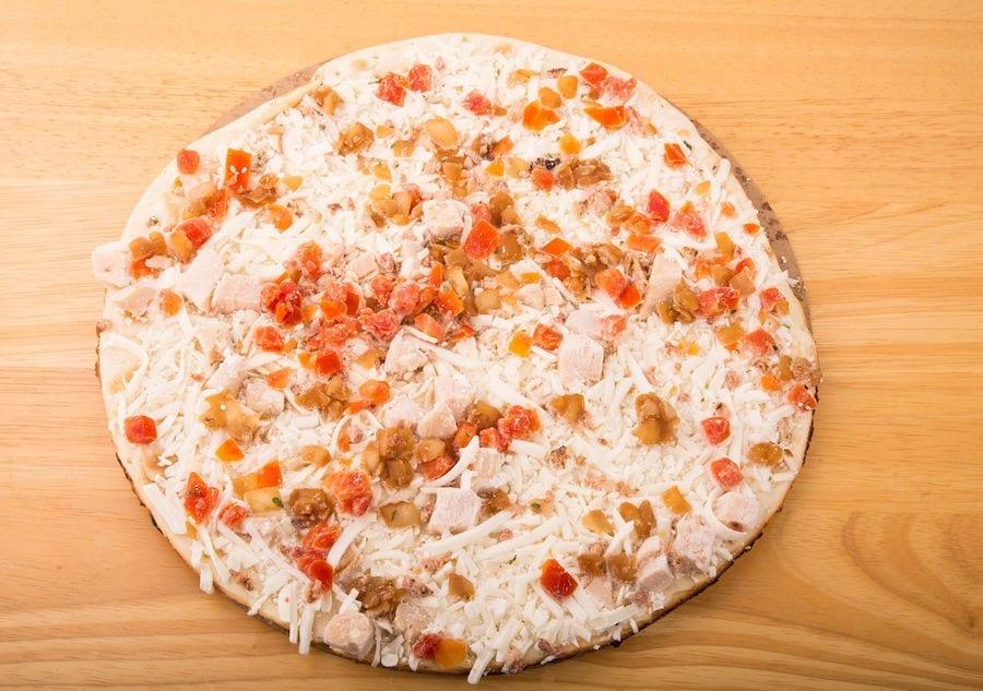 Frozen Margherita Pizza on Cardboard