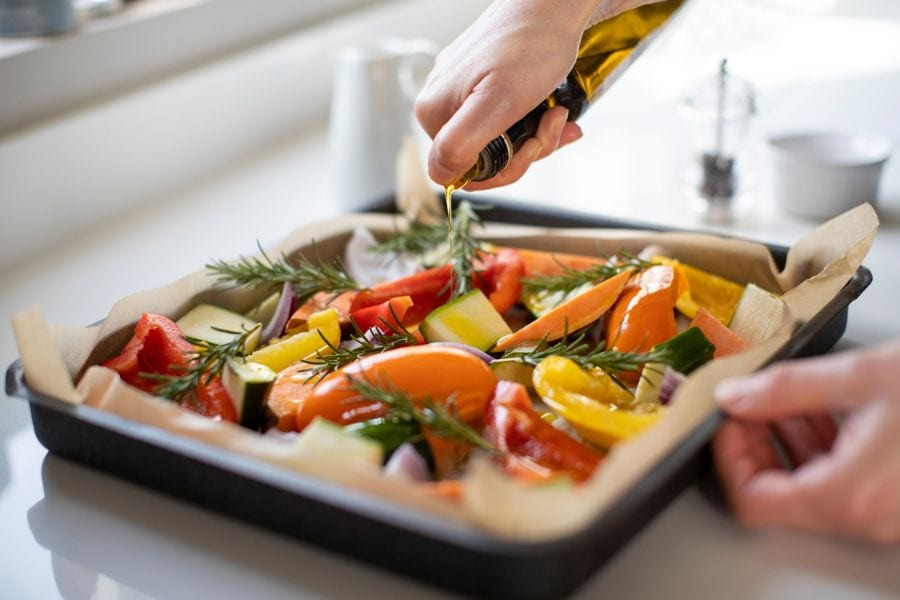 Drizzling Olive Oil on Veggies