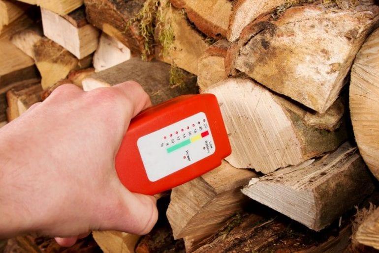 Checking Moisture Level of Wet Firewood