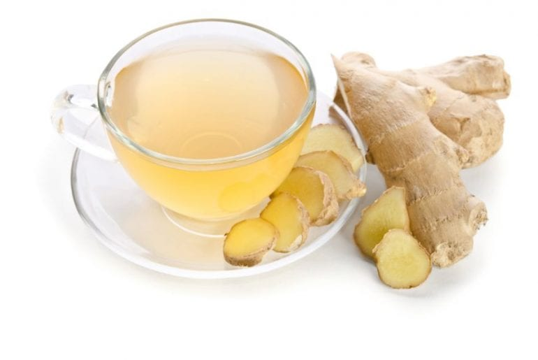 Ginger tea with sliced ginger root