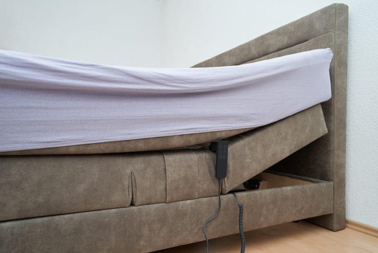 Bed with tilt adjustment mattress bed in the bedroom