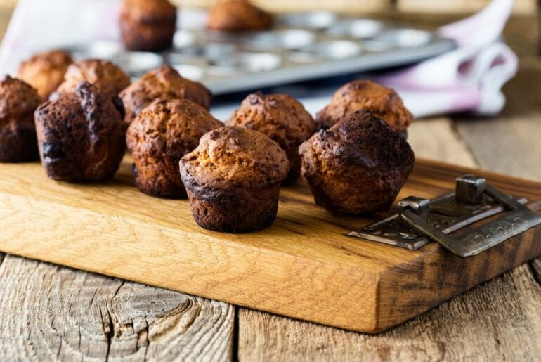 Burnt Muffins on Wood Table