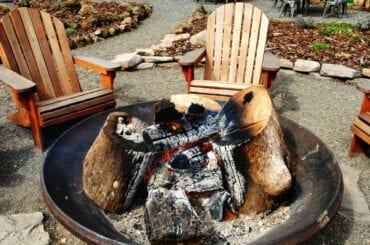 Smoldering Fire Pit With Adirondak Chairs