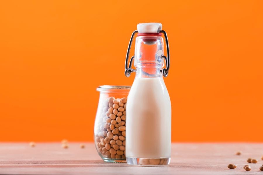 Soy Milk in Bottle With Jar of Soy Beans